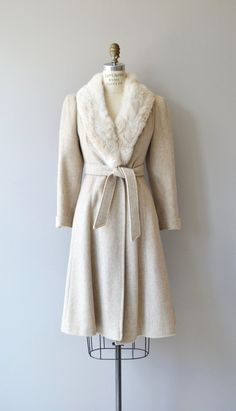 Vintage 1970s pale oatmeal wool coat with white rabbit fur collar, tie collar, hidden pockets and peach acetate lining. --- M E A S U R E M E N T S --- fits like: small shoulder: 14 bust: 32-36 waist: ties to fit hip: free sleeve: 23 length: 40 brand/maker: n/a condition: excellent ★ layaway is available for this item ➸ More vintage coats http://www.etsy.com/shop/DearGolden?section_id=5800175 ➸ Visit the shop http://www.DearGolden.etsy.com ___...