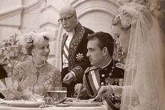 While Princess Grace is enjoying her wedding cake, her mother Margaret Majer Kelly is having a conversation with her brand new son in law, while Prince Rainier's father, Prince Pierre de Polignac, seems to make sure the plates and glasses don't end up empty on the table.