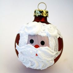 Cute santa ornament.need one medium size round ornament, paint (flesh color, white, black and red),  Snow Tex by DecoArt, paintbrushes.