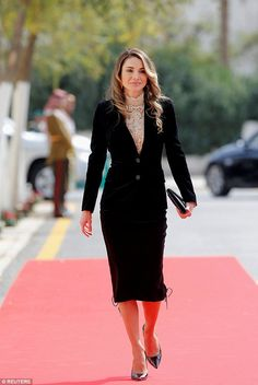 Queen Rania of Jordan arrives for the 18th state opening of parliament in Amman earlier to...