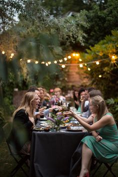 Summer Bucket List: Plan an epic dinner outdoors. Eat, drink, and be merry with old faces and new friends.