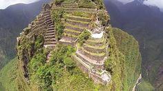 Drone's-eye-view of Machu Picchu in Peru from Wayna Picchu — the taller, harder, way more dangerous-er peak right beside Machu Picchu. From Adventure.com
