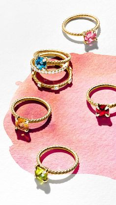 Châtelaine rings with gemstones and diamonds.