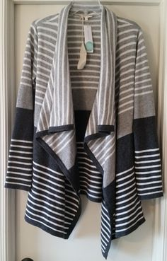 November 2015 Stitch Fix Mystree Chamberlin Striped Drape Front Cardigan (Grey) https://www.stitchfix.com/referral/4371189  I really like the style of this cardigan and that it has a little interest to it. I'm just not sure how draped cardigans would look on a petite frame.
