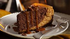 Betty Crocker's chocolate bourbon pumpkin cheesecake is a dynamite dessert. This cheesecake is exploding with flavor. A gingersnap crust is the base while the cheesecake batter is flavored with pureed pumpkin, warm winter spices like ginger Pumpkin Chocolate Cheesecake, Pumpkin Cheesecake Recipes, Dessert Recipes, Desserts, Cheesecake Bars, Pumpkin Recipes, Pumpkin Cakes, Pumpkin Ideas, Drink Recipes