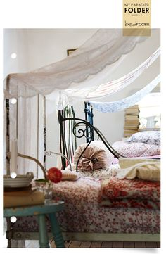 cozy. How beautiful for guests on a sleeping porch.