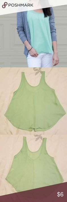 """Lush Flowy Tank Top in XS Lush tank top in light green. Kind of see-through so I typically wore a cami underneath to make it work appropriate. Very tiny snag and stain (last photo) in the chest area but it's not that noticeable since it's so flowy. Back neckline is lower than front. ~25"""" from shoulder to bottom hem.   100% polyester. Says dry clean only but I've put in washer many times and if you hang/line dry it's perfectly fine.  Comes from a home with dogs. Lush Tops Tank Tops"""