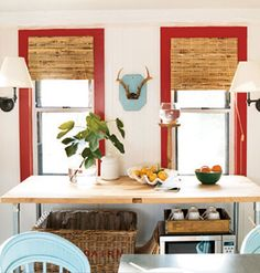 Colored window trim, antlers, wood table.