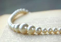 Necklace - Pearl Necklace - Cream Necklace - Pearl Strand - Swarovski Pearls - Selena Kyle - Bruce Wayne - Batman - Catwoman. $40.00, via Etsy.