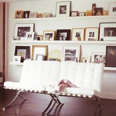 I really love these gallery shelves.  Swap out frames and pics in no time!