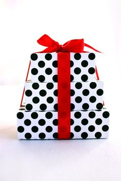 black and white polka dot gift boxes with hot pink ribbon