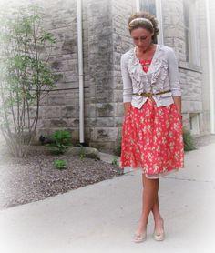 Skirt underneath dress to add a ruffle + feminine cardigan + tied belt.