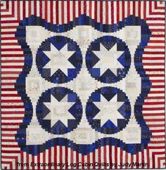 """Main Street Log Cabin quilt – Extraordinary Log Cabin Quilts, 2013. The book is due out in the fall of 2013. Designed and pieced by Judy Martin. Quilted by Lana Corcoran. 60"""" x 60"""". Alternate size of 96"""" x 96"""" also presented. I had pinned an earlier snapshot of this quilt. This is the photograph that will appear in the book."""