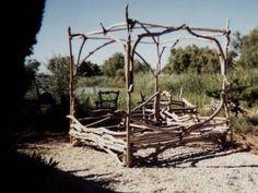 Driftwood bed. Grow climbing plants around it?