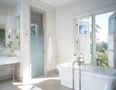 fully enclosed shower, also like the nickel frame base under the sink counters
