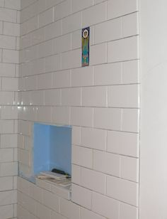 Shower personalized with a few detail tiles added from a trip to Italy.