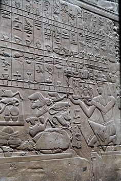 Hieroglyphs at Luxor Temple by DSLEWIS, via Flickr