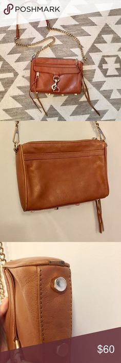 """Rebecca Minkoff Mini Mac in Cognac Beautiful Rebecca Minkoff mini Mac crossbody in a chic rich cognac color. Used, but still in excellent condition. Minor signs of wear on the bottom corners as shown, but hardly noticeable. Usual wear on gold, but not noticeable. No color rub from jeans on back. Inside is clean and in great condition. A couple little pinkish marks as shown in photo, but could probably come out with stain remover. No dust bag. 9"""" wide x 1.5"""" deep x 6.5"""" tall. Adjustable…"""