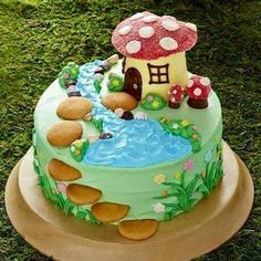 Fairy Garden Cake No party is complete without a birthday cake and this fairy garden is simply magical! Its made easy with cake mix ready-made frosting and lots of candy and sprinkles. Fairy Garden Cake, Garden Cakes, Fairy Cakes, Fairy House Cake, Food Cakes, Cupcake Cakes, Bolo Lego, Toadstool Cake, Mushroom Cake