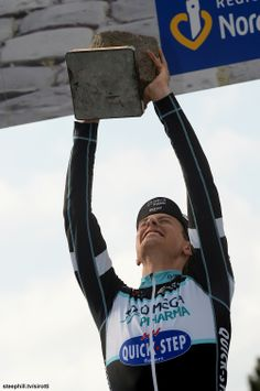 Niki Terpstra (Omega Pharma - Quick Step) just barely passes the post-race cobble clean and jerk