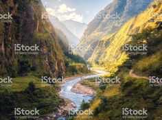 Colorful landscape with high Himalayan mountains, beautiful curving river, green forest, blue sky with clouds and yellow sunlight at sunset in summer in Nepal. Travel in Himalayas royalty-free stock photo Nepal, Sky And Clouds, Stock Foto, Himalayan, Royalty Free Stock Photos, Sunset, Mountains, Sunlight, Homecoming