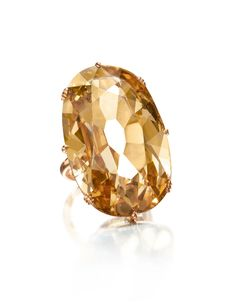 49.31ct Mughal-cut golden Golconda diamond ring, set into a simple contemporary mount called the 'Maharaja Sunset', by Siegelson.