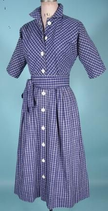 "c. 1951 CLAIRE MCCARDELL Clothes by Townley Blue and White Cotton (Light Canvas Weight) Dress with Original Tie Sash! Deaccessioned from a museum, still has the museum satin tag (see link). Blue and white windowpane pattern dress with short sleeves and white plastic buttons up front. Comes with the original long, 135"" long flat matching sash to tie around the waist. 2 pockets at sides."