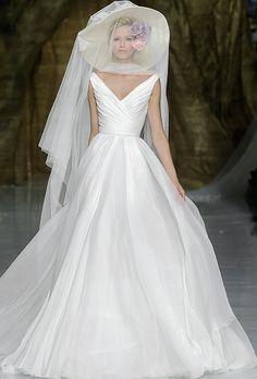 "Brides.com: Pronovias - Spring 2014. ""Yesel"" sleeveless silk organza ball gown wedding dress with a deep v-neckline and ruched bodice, Pronovias"
