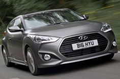 Hyundai will commence the sale of new Veloster 1+2 coupe in the UK from September 24, 2012. Prices start from £21,995 and the sportier hatch will be fitted with a 1.6 liter turbocharged petrol engine. As per European specifications, Hyundai Veloster Turbo SE will generate output of 183 bhp and peak torque of 195 lb/ft. It will be mated to a six speed manual gearbox and will be able to accelerate from 0 to 62 mph in 8.4 seconds while reaching a top speed of 133 mph. Fuel economy ...