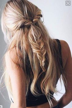 half up half down hairstyle with a fishtail