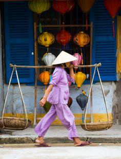 Vietnam, Quang Nam, Hoi An, woman carrying baskets by lantern shop