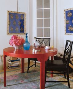 glossy red table, black chairs, multi colored accessories