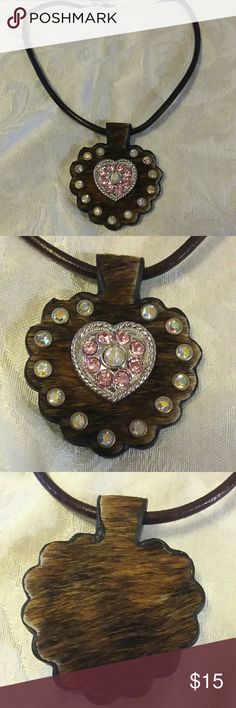 """Genuine cowhide rhinestone studded pendant Genuine cowhide rhinestone studded pendant.  Front and back all genuine cowhide. Front is decorated with rhinestones and a silver heart in middle either pink rhinestones.  16"""" brown corded necklace with 2"""" extender. Jewelry Necklaces"""