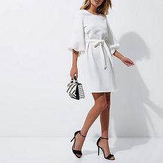 Textured woven fabric Three quarter puff sleeve Tie waist belt Swing style Loop back fastening Our model wears a UK 8 and is tall Evening Dresses, Dresses Dresses, Swing Dress, Woven Fabric, Your Style, Party Dress, Tie, Lady, Model