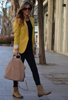 Mustard blazer and black top and pant, beige boots