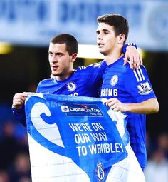 Eden Hazard and Oscar celebrate progressing to the Capital One Cup final in Wembley.