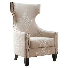 """Showcasing beige linen upholstery and hand-applied nailhead accents, this eye-catching arm chair brings stately style to your master suite or living room.    Product: ChairConstruction Material: Birch wood, polyurethane foam and linenColor: Beige and dark brownFeatures:19.69"""" Seat heightTrack armsRemovable seat cushionHand-applied copper nailhead trimDimensions: 47.64"""" H x 30.12"""" W x 32.3"""" DCleaning and Care: Spot clean onlyAssembly: Assembly required - hardware included"""