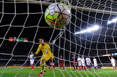 Lionel Messi (not in picture) of FC Barcelona scores his team's first goal during the La Liga match between FC Barcelona and Sevilla FC at Camp Nou on February 28, 2016 in Barcelona