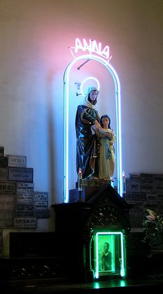 A neon lit altar in honour of St Anne, the mother of Mary, and St Martin de Porres in Ho Chi Minh City, Vietnam.