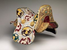 Saddle [Gser Sga] (image 1) | Tibetan; Derge | 1942-46 | Copper alloy, iron, gold, turquoise, wood, leather, silk, cotton | Metropolitan Museum of Art | Accession Number: 2008.81a | Made for nobleman Yuthok Tashi Dundrup (1906–1983), who commissioned the saddle when he assumed the post of governor of eastern Tibet in 1942.