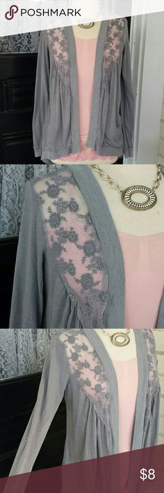 Grey long sleeve throw over sweater with lace. Large size cartigan.  Grey with lace.  There is a small hole in lace I posted in the last picture.  Ive never worn this so maybe it happened with handling at some point. Sweaters Cardigans