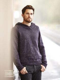 Clifton - Knit this mens stocking stitch hooded sweater from Easy Aran Knits, a design by Martin Storey using the stunning Fine Art Aran (wool, kid mohair, super fine alpaca and mulberry silk). With fully fashioned raglan sleeves and a garter stitch hood, this knitting pattern is for the intermediate knitter.