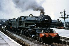 6025 King Henry III & 5058 Earl of Clancarty at Newton Abbot in July 1955.