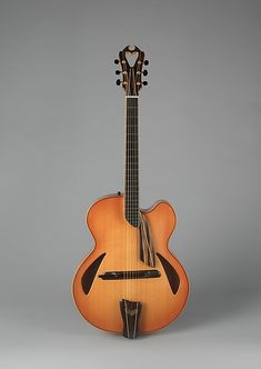 Archtop Guitar. James DAquisto  (American, New York 1935–1995 Corona, California) Date: 1993 Geography: Greenport, New York, United States Medium: Spruce, maple, ebony
