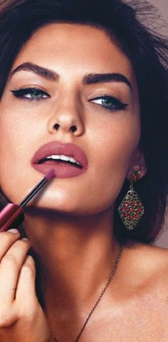 Gorgeous women. Bright appearance. Italian-like, olive skin, dark hair and brows, sensual lips.