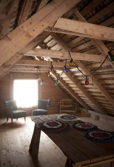 Loft space used not for storage or bedroom.... cute lighting