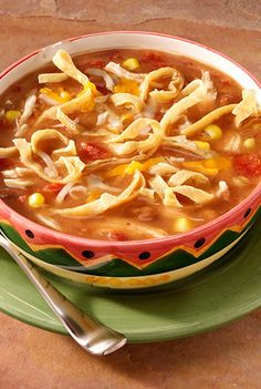 Chicken tortilla soup recipe combines spicy tomatoes, refried beans, corn and chicken with chicken broth for a quickly prepared soup