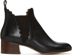 Ankle-high 'soft' calfskin boots in black. Round toe. Scalloped collar…