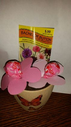 Awsome Valentines gift! Cut out flowers with a tootsie pop in the middle. Put flowers in a pot filled with soil and a seed packet to plant real flowers!