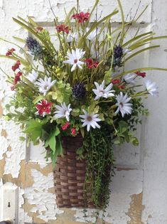 Basket wreaths on pinterest front doors baskets and Spring flower arrangements for front door